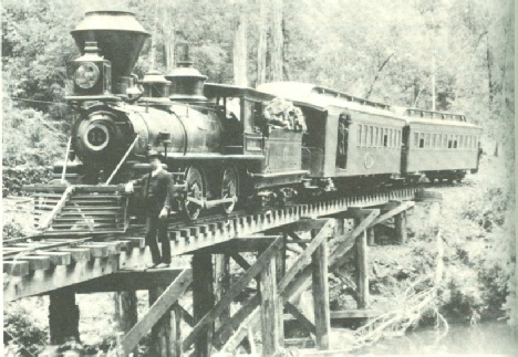 Northwestern Pacific narrow gauge train crossing Austin Creek on the way to Elim Grove.  This is the same train configuration that the scouts would take, c 1920